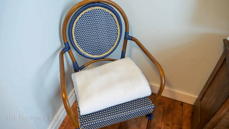 image: antique chair with blue fabric