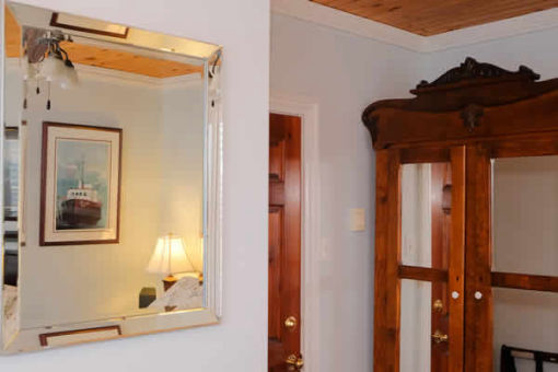 image: wall with mirror and wood cabinet