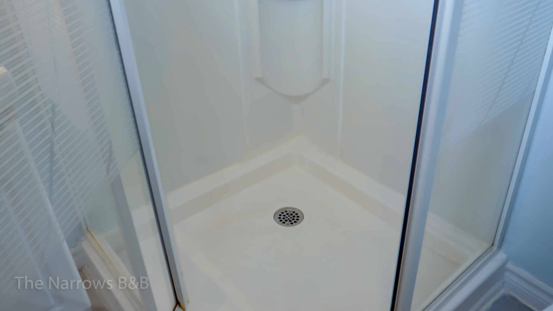 image: interior white stand up shower stall